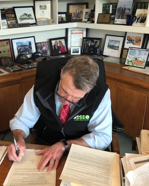Gov. Phil Scott signs the stay at home order on Tuesday, March 24.