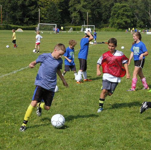 Jack McHale, left, attempts to elude Casey Sibilia during a drill at the 2014 Deerfield Valley  Soccer Camp.  The annual summer camp returns for its 32nd year in August.      File photo
