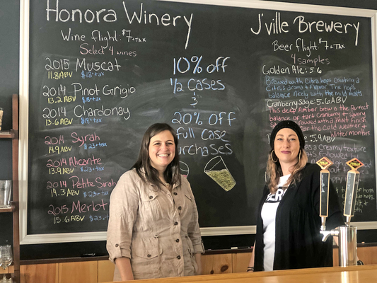 Janice Stuart, left, and Danielle Wade behind the bar at the Honora tasting room in Dover. The duo plans to continue the legacy left by Honora's founder, Patty Farrington.