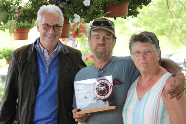 Bucky and Janet Boyd. above, accepting the award from Mark Wallace, left, who represented the Make-A-Wish Foundation of Vermont. T. Lederer.