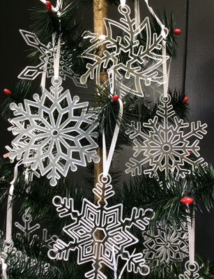 The beautiful glass snowflakes are just a few of the ornaments available. These are sandblast carved in clear glass.