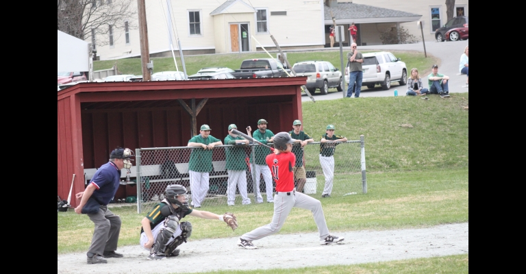 Twin Valley's Eric Bolognani, 11, cracks a single during last Thursday's game with Green Mountain.                                                                                                                   