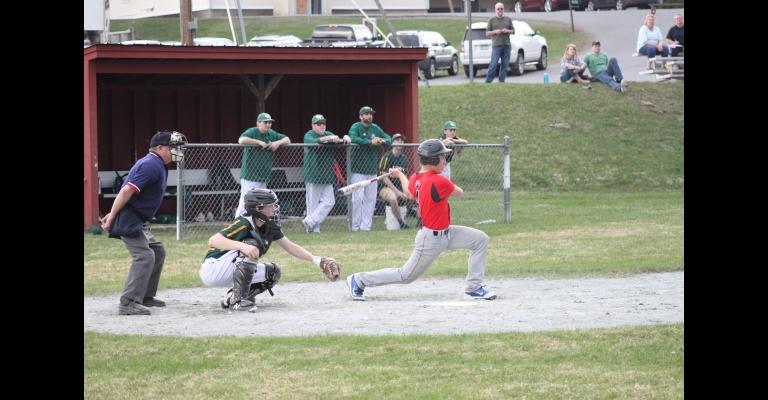 Izaak Park takes a cut against Green Mountain. Photo by Randy Capitani