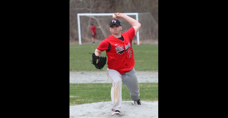 Joey Rafus delivers a pitch during the Green Mountain game. Photo by Randy Capitani