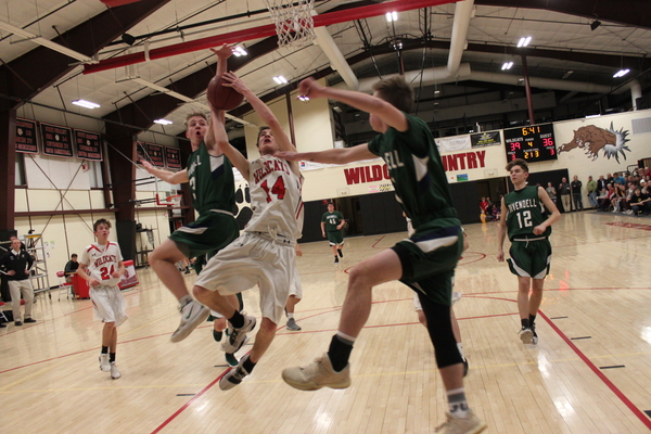 Twin Valley's Jack McHale, 14, goes in for a layup between Rivendell's Zach Gould and Tanner Siemons. McHale led the Wildcats to a quarter-final round win over the Raptors.