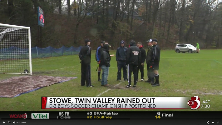 Coaches and officials confer in front of a rain-soaked goal before deciding to postpone Saturday's match between Twin Valley and Stowe.