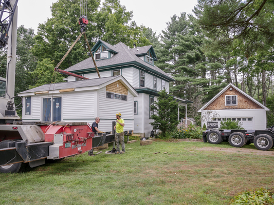 Contractors work on attaching the WheelPad XL to the home of Edmond Little.  The accessible addition was designed by WheelPad LLC, of Wilmington, and built by students at Norwich University.