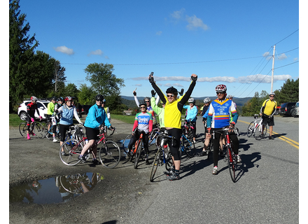 A group of Hungry Lion tour riders celebrate after finishing the final climb to Town Hill in Whitingham. The hunger-fighting charity ride returns on September 29.