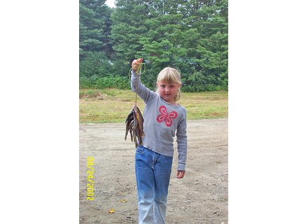 Kayla Lackey holds up a string of fish she caught at the Readsboro Family Park in 2002. A playground is being built at the park by a nonprofit started in her memory by her parents.