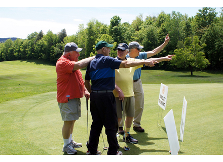 The Deerfield Valley Rotary Club held its annual Putt 'n' Pour on Friday. Twenty-four teams came out to play. The money raised supports Rotary scholarships and local organizations including the Southern Vermont Therapeutic Riding Center, Kayla's Playground, Wings, Grace Cottage Hospital, and others. Here, a team tries to figure out the lie of the ball on a green.  Photos by Sarah Shippee