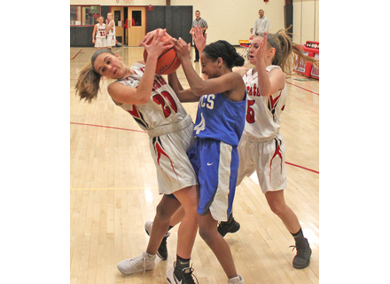 Twin Valley's Jayden Crawford, left, and MVC's Rachel Horner-Richardson battle for the ball while Kylie Reed tries to get in on the action.              