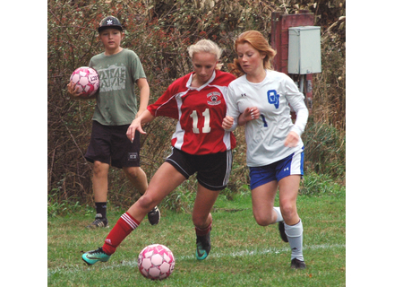 Twin Valley's Morgen Janovsky, 11, works the ball along the sideline in Saturday's match against Otter Valley. The Wildcats lost to the Otters 3-1.