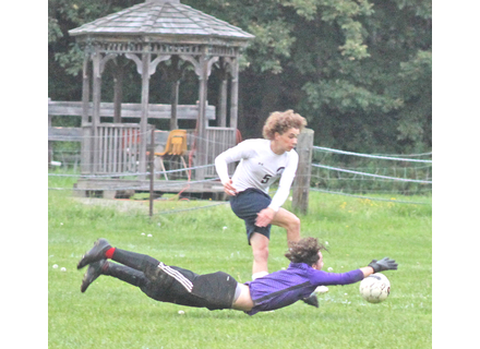 Twin Valley goalkeeper Liam Wendell stretches out to make a diving save on a shot taken by Stratton's Elliot Deleger during the first half of Friday's soccer match. Randy Capitani