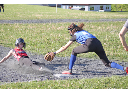 Twin Valley's Jazmyn Dix slides safely into third base ahead of the tag during the Wildcats' win over Thetford. Photos by Randy Capitani