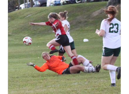 Twin Valley's Kylie Reed steps over West Rutland goalkeeper Serena Coombs to chase down the ball during Tuesday's match at Hayford Field. Reed scored the Wildcats' only goal on the play.