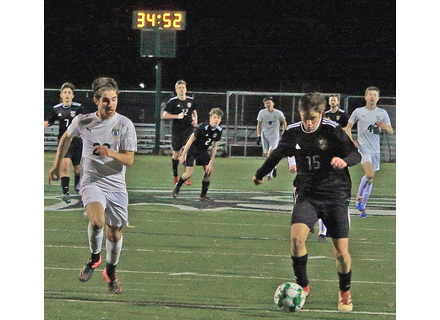 Twin Valley's Owen Grinold, 15, broke free behind Stowe's Owen Leppiko for a shot early in the second half of Wednesday's match.                                                                                 Photo by TJ Sibilia