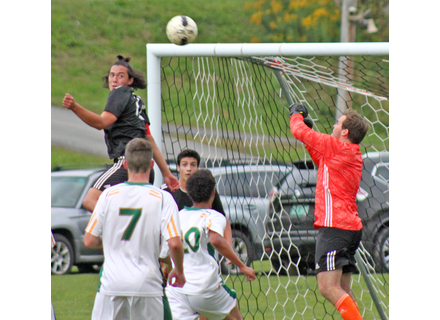 Twin Valley's Izaak Park, left, eyes the ball as goalie Jack Kehoe punches the ball clear during Tuesday's 4-2 win over White River Valley.                                                            