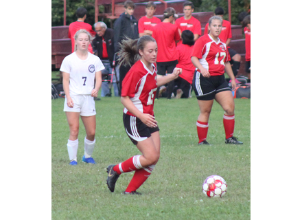 Stratton's Eliza Sullivan, #7, and Twin Valley's Kara Bird, #17, watch as Sadie Boyd pushes the ball on the attack. Sullivan has tallied five goals in Stratton's two meetings with the Wildcats.                                                        RC/file photo
