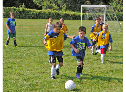 Kids play soccer at the camp