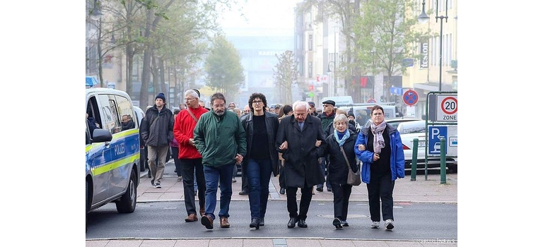 "Ellie Roden, second from the right, walks with others whose families were victims of the Holocaust and Nazi persecutions. Roden said this was a ""silent march to the train station in Fulda (Germany), taking the same route our ancestors did on their way to being deported to concentration camps."""
