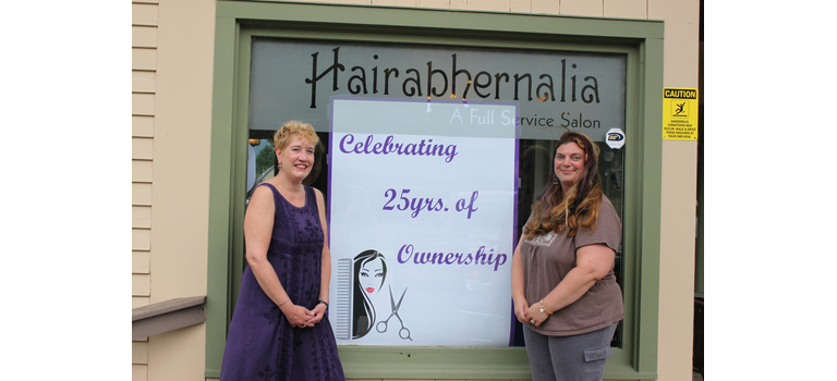 Lisa Lunde Johnson, left, and Karina Morehead, right,  will welcome the public to Hairaphernalia for an open house on Saturday, August 18.