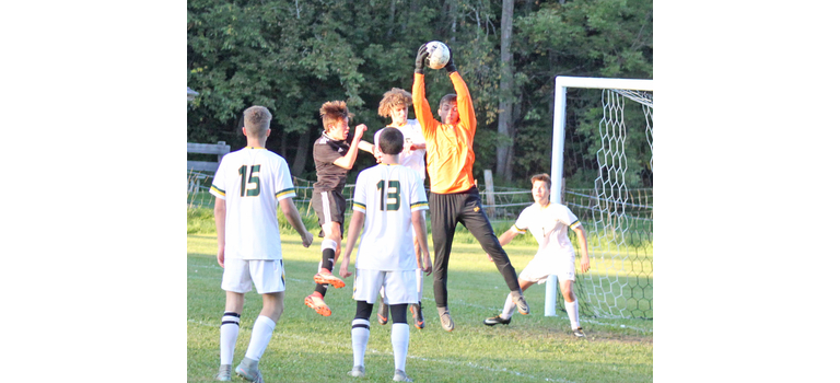 Green Mountain goalkeeper Skyler Klezos leaps to grab a Twin Valley corner kick during Wednesday's match.  Klezos' stellar play between the pipes allowed the Chieftains to come away with a 1-0 overtime win. It was Twin Valley's first regular-season loss in two years.