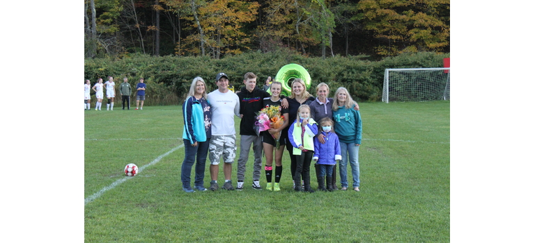 Senior Alyssa Bird was recognized with her family before Friday's match with Long Trail. RC