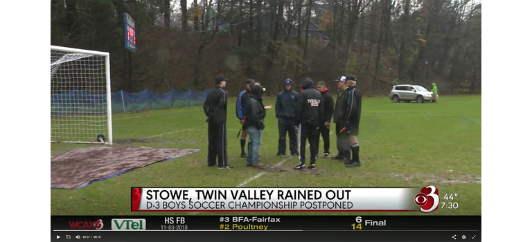 Coaches and officials confer in front of a rain-soaked goal before deciding to postpone Saturday's match between Twin Valley and Stowe. Image courtesy WCAX.com
