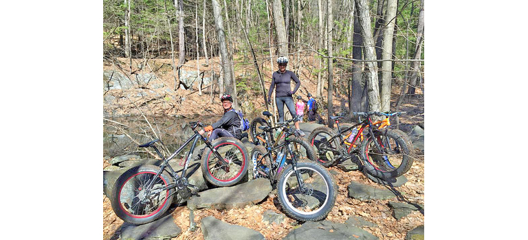 Mike Purcell, left, and Tracy Hunt take a break during a group trail ride on the east side of Wilmington.