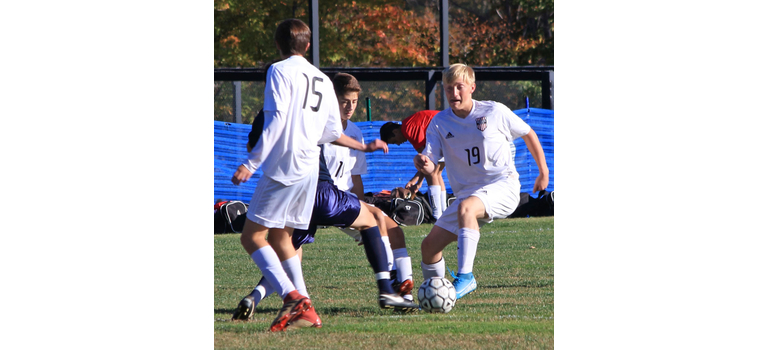 Twin Valley's Owen Grinold, #15, Lucas Messing, and Ayden Loos surround a Stratton player.           TJ Sibilia