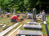 Tom Maroni and Joel Hicks work on a new foundation for a headstone in Readsboro in this file photo from 2016.  Resetting a headstone requires significant work on the foundation as well as, in many cases, repairs to the headstone itself.