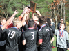 Twin Valley players celebrate with the trophy following the match.