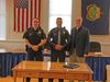 Joseph Carcich, center, was sworn in to the Wilmington Police Department earlier this month. Flanking Carcich is chief Matt Murano, left, and town manager Scott Tucker.