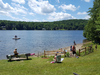 Swimmers and sunbathers enjoying Green Mountain Beach at Lake Raponda earlier this summer.  The popular Wilmington beach has been closed twice this summer.                                                                                                                 Randy Capitani