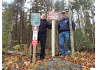 Wilmington Trails Committee members Spencer Crispe, left, and Jake White at the trailhead for the Raponda Primitive Trail, which starts on the west side of Lake Raponda