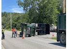 This truck tipped over after catching its raised bed on a power line near the corner of Davis and East Dover roads Tuesday afternoon. The truck had delivered hot asphalt to a paving project on Dover Hill Road and had stopped to have its bed cleaned out when the accident occurred. No injuries were reported.