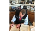 Gov. Phil Scott signs a COVID-19 order.