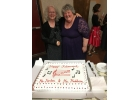 Karen Horton, left, and Sue Maddern share a hug and a laugh at a retirement party last week at TVHMS.