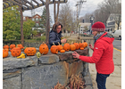 Lisa Sullivan, left, and Meg Staloff set up new jack-o'-lanterns at the Bank Park Wednesday afternoon, after the original pumpkins were smashed by an unknown person.