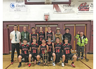 The Twin Valley boys' varsity basketball team posed with the championship trophy after winning the Bob Abrahamson Basketball Tournament Friday evening at Proctor.    