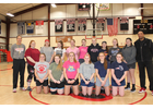 The Twin Valley Middle High School girls' varsity and junior varsity basketball players include, front row from left: Sadie Boyd, Jesse Lazelle, Celia Betit, Kylie Reed, Jayden Crawford, and Alexis Boyd.  Back row, from left: varsity coach Buddy Hayford, Shelbea Fournier, Leora Longe, Kayleigh Richard, Jordyn Trowt, Winter Nakos, Katelyn Longe, Alyssa Bird, Jazmyn Dix, Hannah Sullivan, and JV coach James Anderson. Missing from the photo is Paige Cunningham.     RC